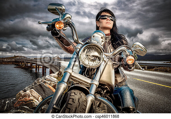 Biker girl on a motorcycle - csp46011868