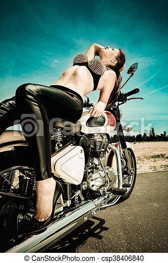 biker girl on a motorcycle - csp38406840