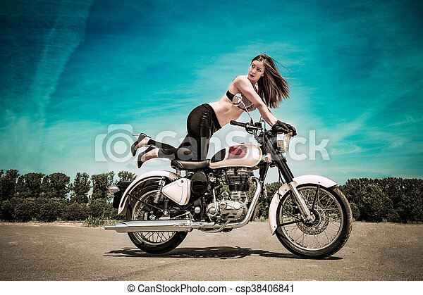 biker girl on a motorcycle - csp38406841