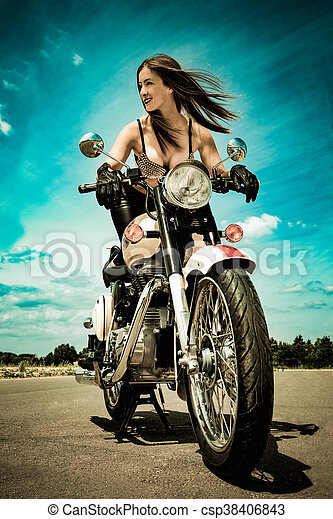 biker girl on a motorcycle - csp38406843