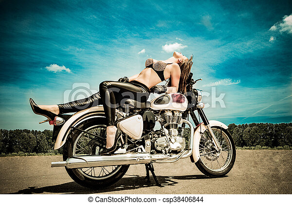 biker girl on a motorcycle - csp38406844