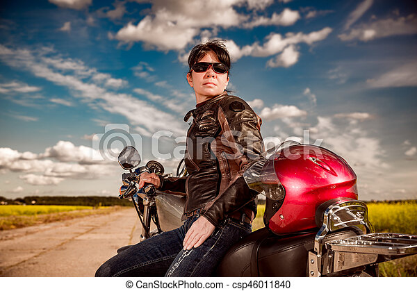 Biker girl on a motorcycle - csp46011840