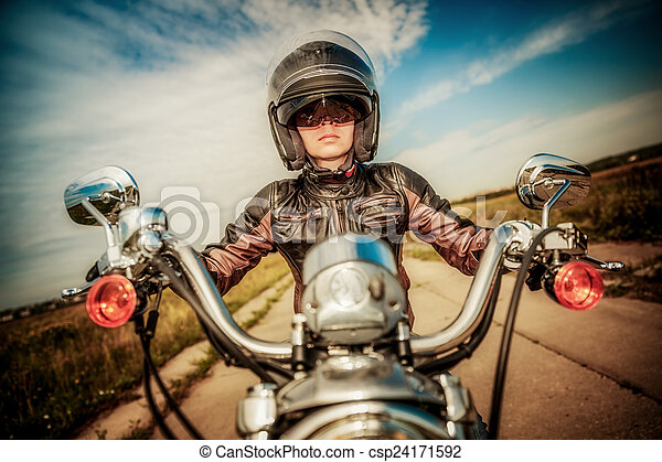 Biker girl on a motorcycle - csp24171592