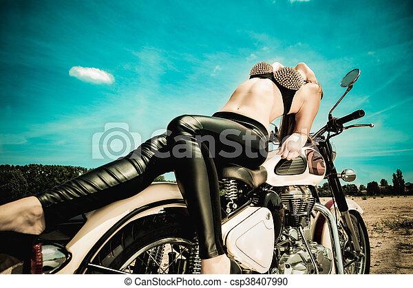 biker girl on a motorcycle - csp38407990
