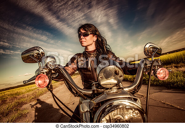 Biker girl on a motorcycle - csp34960802