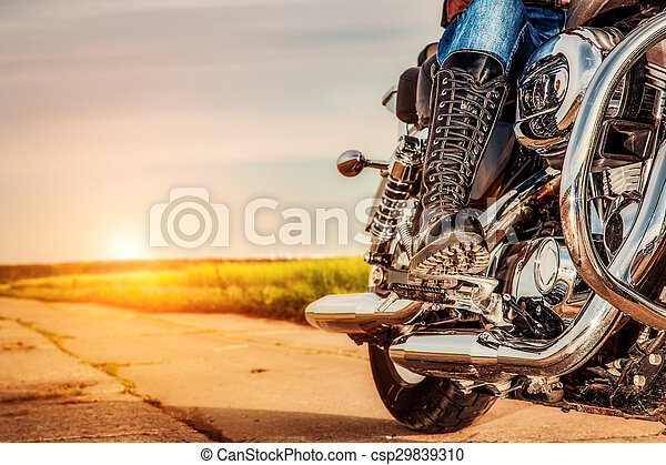 Biker girl riding on a motorcycle - csp29839310