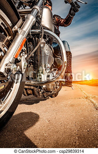 Biker girl riding on a motorcycle - csp29839314
