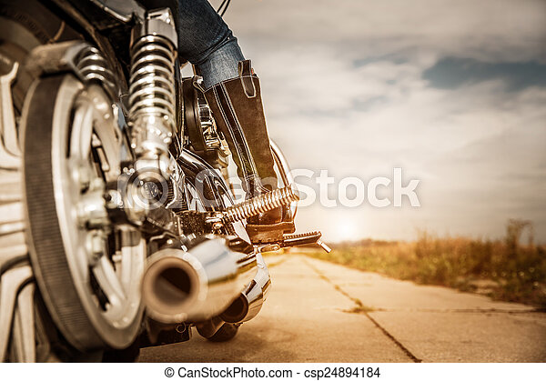 Biker girl riding on a motorcycle - csp24894184