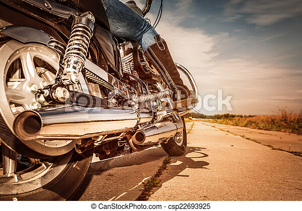 Biker girl riding on a motorcycle - csp22693925
