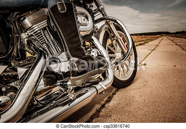 Biker girl riding on a motorcycle - csp33616740