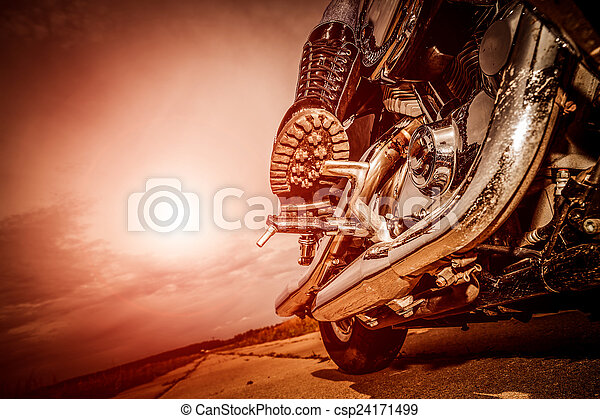 Biker girl riding on a motorcycle - csp24171499