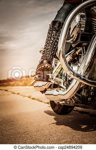 Biker girl riding on a motorcycle - csp24894209