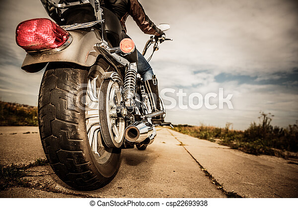 Biker girl riding on a motorcycle - csp22693938