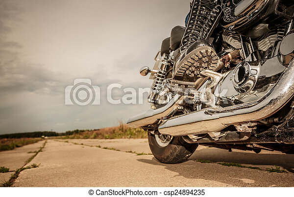 Biker girl riding on a motorcycle - csp24894235