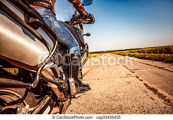 Biker girl riding on a motorcycle - csp33435435