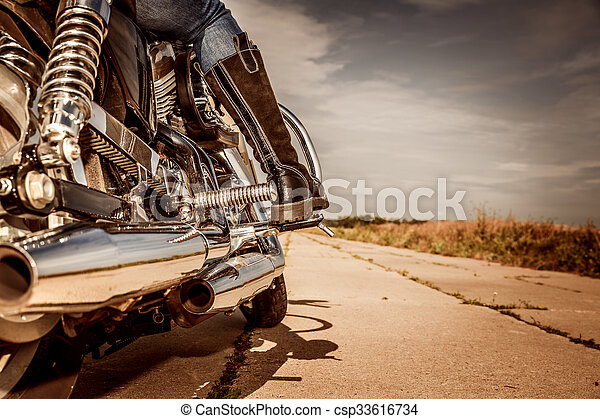 Biker girl riding on a motorcycle - csp33616734