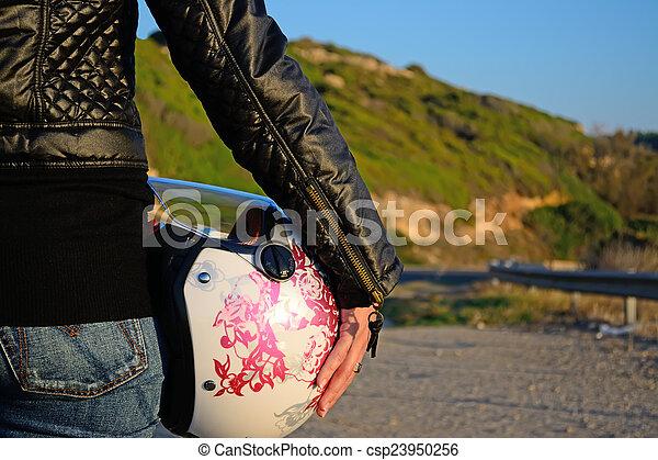 biker girl with helmet - csp23950256