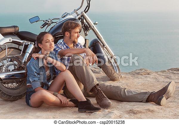 Biker man and girl sits - csp20015238