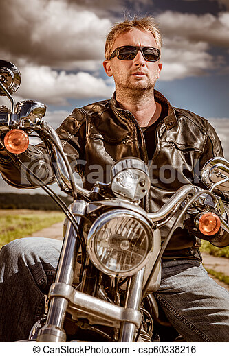 Biker on a motorcycle - csp60338216