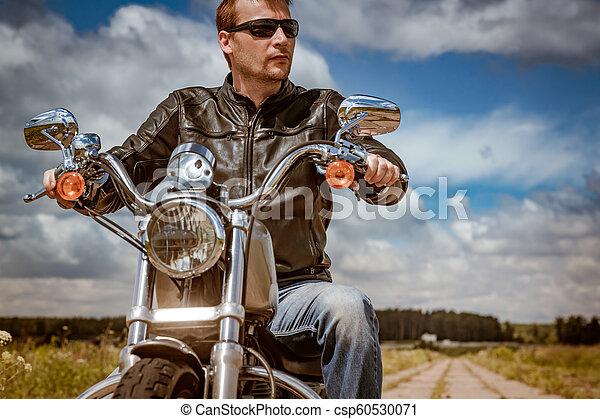 Biker on a motorcycle - csp60530071
