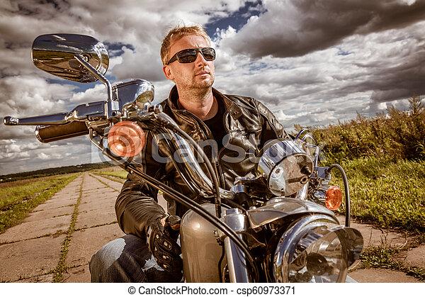 Biker on a motorcycle - csp60973371
