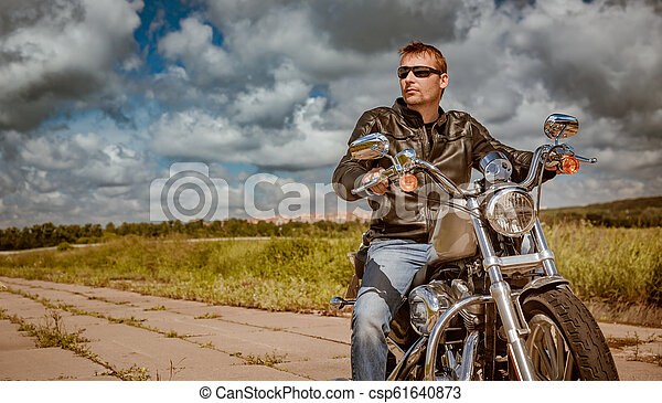 Biker on a motorcycle - csp61640873