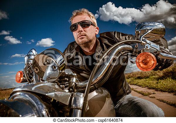Biker on a motorcycle - csp61640874