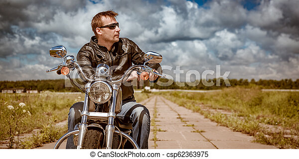 Biker on a motorcycle - csp62363975