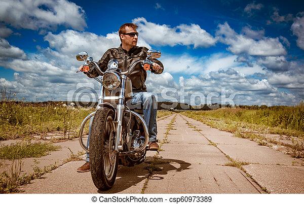 Biker on a motorcycle - csp60973389