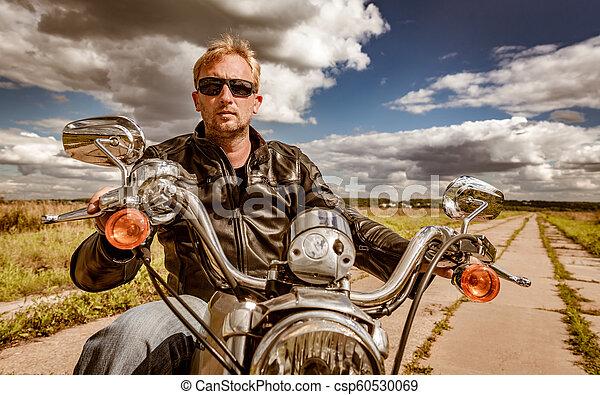 Biker on a motorcycle - csp60530069