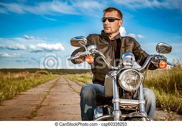 Biker on a motorcycle - csp60338253