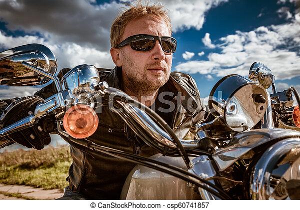 Biker on a motorcycle - csp60741857