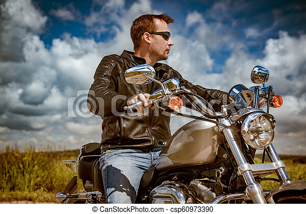 Biker on a motorcycle - csp60973390