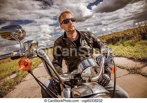 Biker on a motorcycle - csp60338232