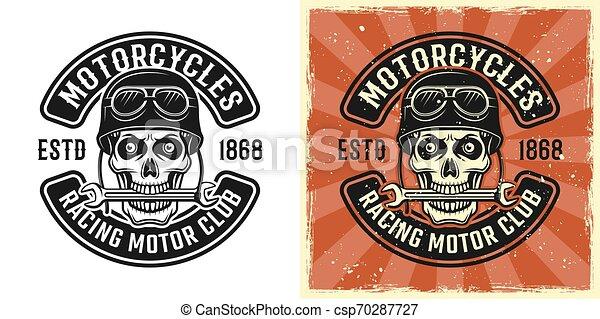Biker skull in helmet with wrench in teeth emblem - csp70287727