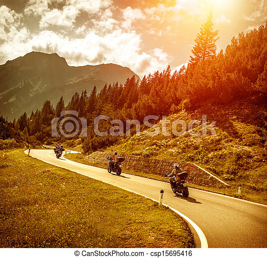 Bikers on mountains road in sunset - csp15695416