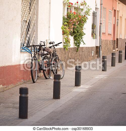 Bikes parked on the street - csp30168933