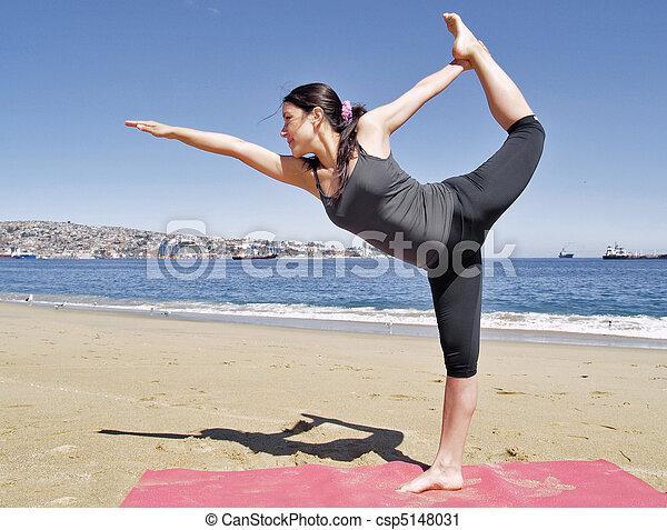 bikram yoga dandayamana dhanurasana pose at beach yoga
