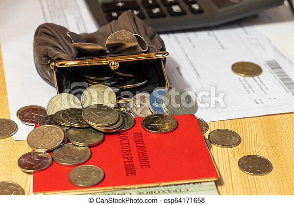 """Bill for payment, points, wallet with coins and calculator on the table surface. Translation of the inscription: """"pensioner's Certificate"""" - csp64171658"""