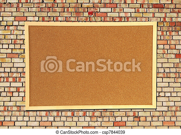 Billboard sign on an old red brick wall - csp7844039