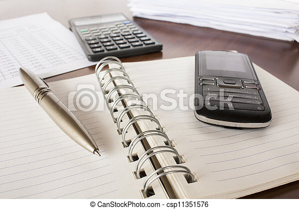 bills ,pen .cell phone,notebook and calculator,accounting - csp11351576