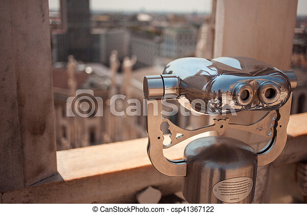 Binoculars on the roof of Duomo in Milan, Italy. Top view to the city, Sunny day - csp41367122