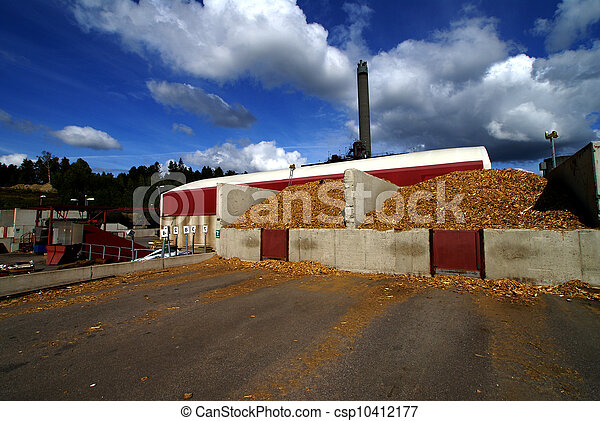 bio power plant with storage of wooden fuel against blue sky - csp10412177