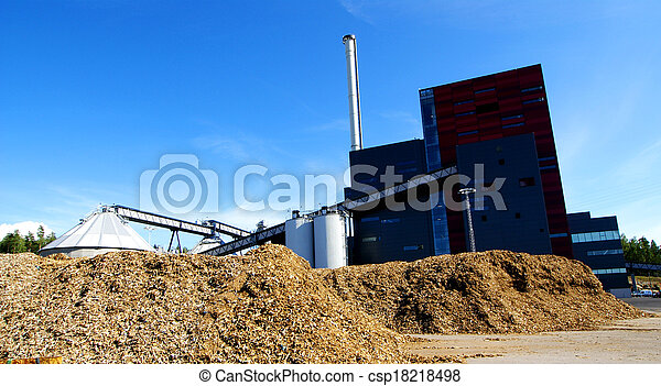 bio power plant with storage of wooden fuel against blue sky - csp18218498
