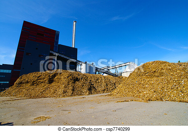 bio power plant with storage of wooden fuel against blue sky - csp7740299
