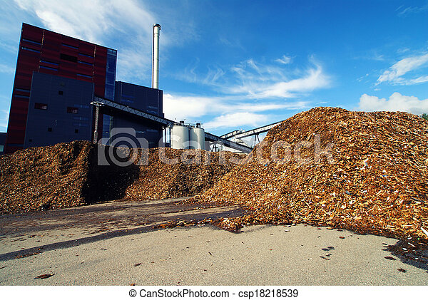 bio power plant with storage of wooden fuel against blue sky - csp18218539
