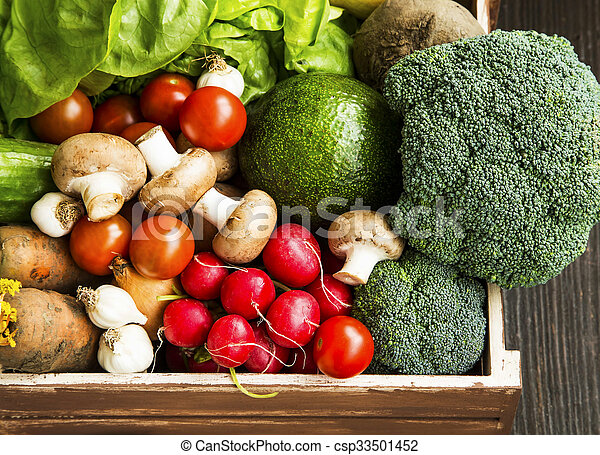 Bio vegetables in wooden crate with radish, salad, mushrooms, broccoli, tomatoes - csp33501452