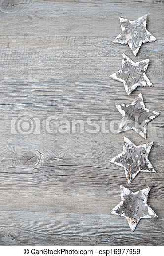 Birch bark stars over the wooden background - csp16977959