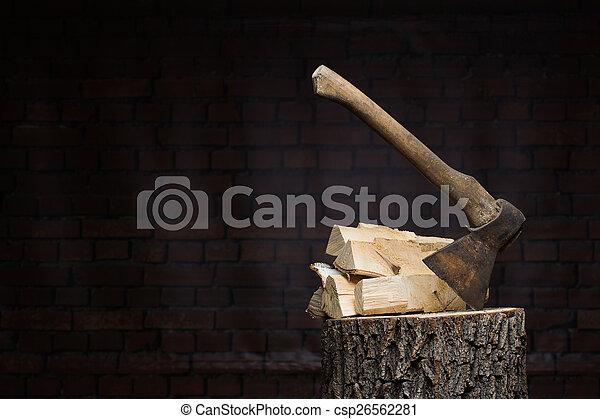 birch firewood, old rusty ax  - csp26562281