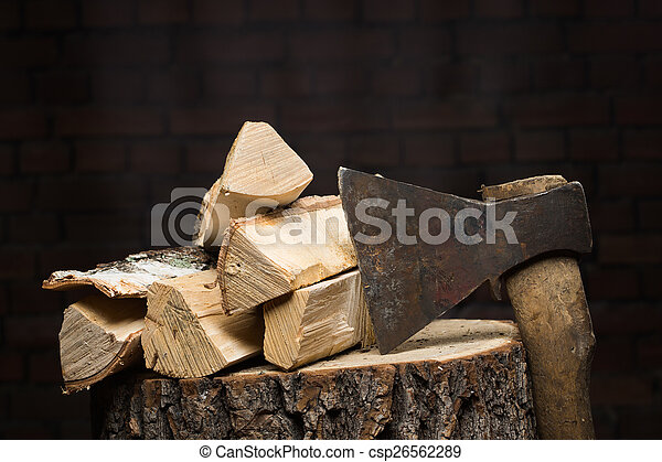birch firewood, old rusty ax  - csp26562289